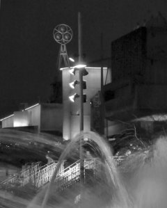 A semi-abstract composition with a South Bank fountain in the foreground and the Queen Elizabeth Hall beyond...