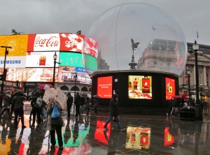 Eros in a bubble in the rain at Piccadilly Circus